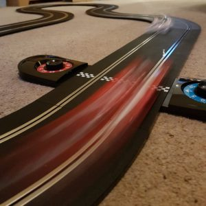 Cars speeding by on the Scalextric track