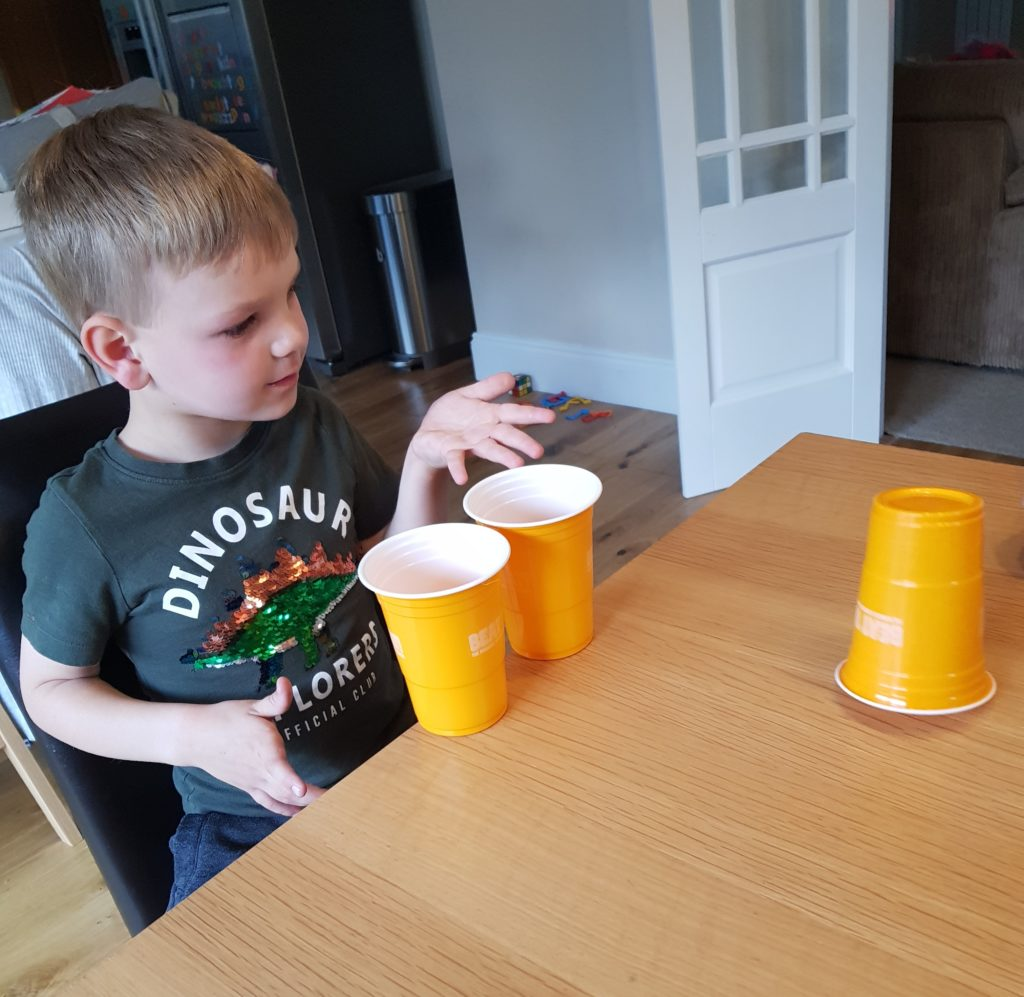 Joshua tryig out the cup flipping challenge