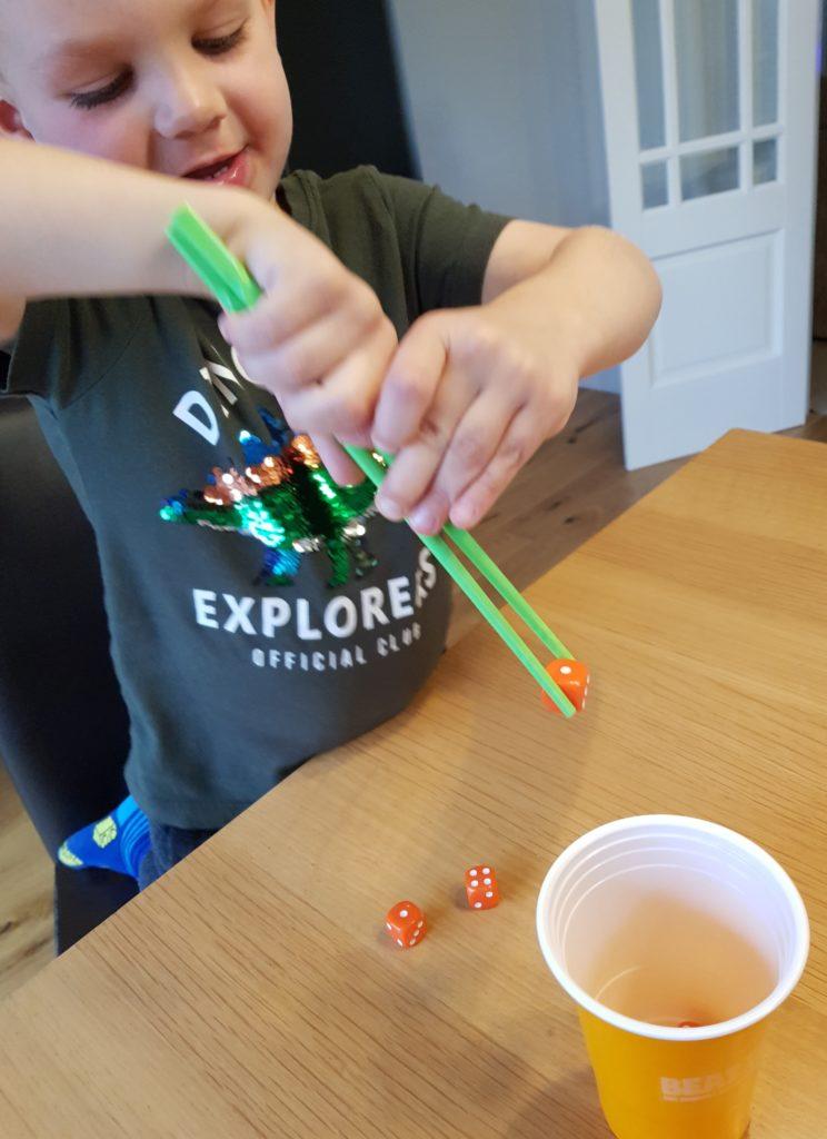 Joshua trying the chopsticks challenge