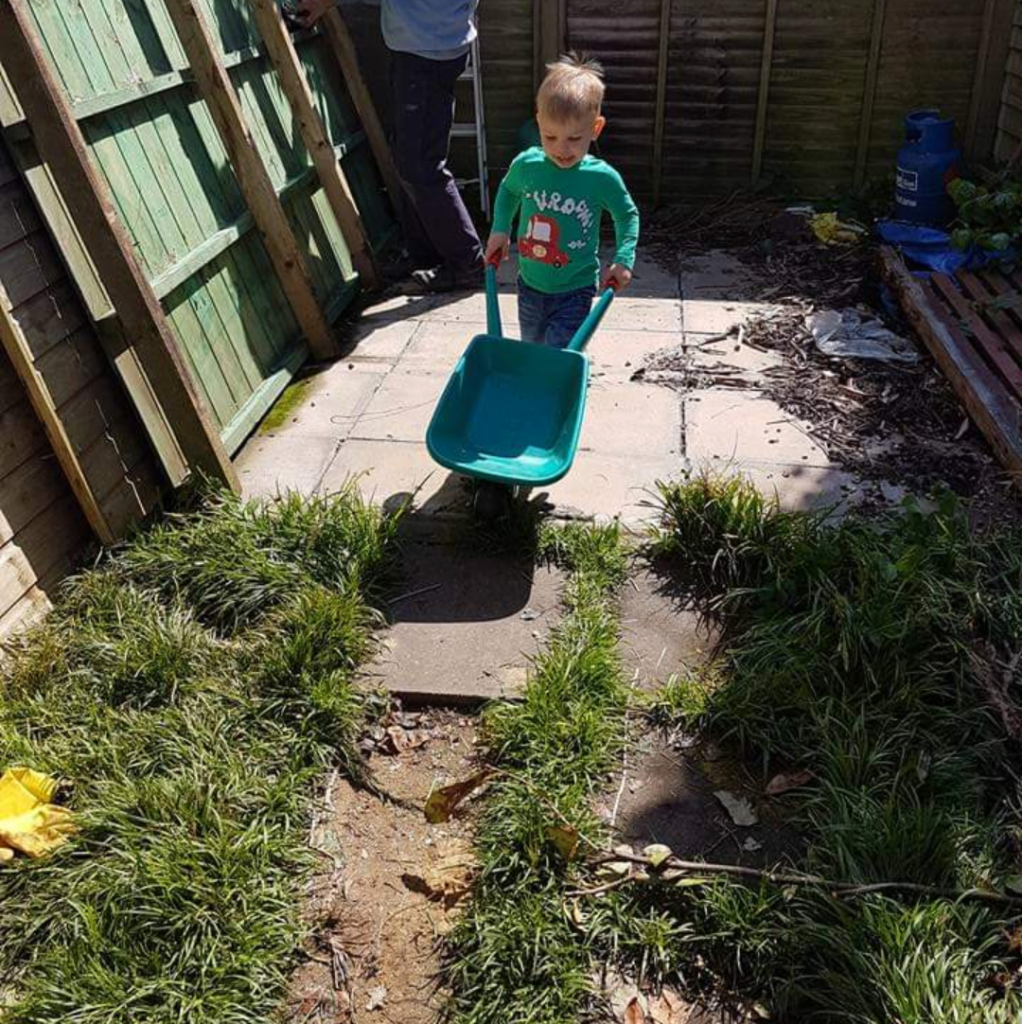 Joshua pushing wheelbarrow